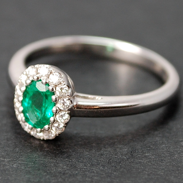 18ct White Gold Emerald and Diamond Oval Cluster Ring in Modern Jewellery from Coopers Jewellery, North Devon