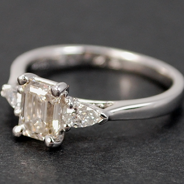 Platinum Emerald Cut and Pear Shape 3 Stone Diamond Ring in Modern Jewellery from Coopers Jewellery, North Devon