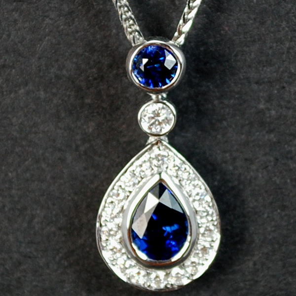 18ct White Gold Sapphire and Diamond Drop Pendant in Modern Jewellery from Coopers Jewellery, North Devon