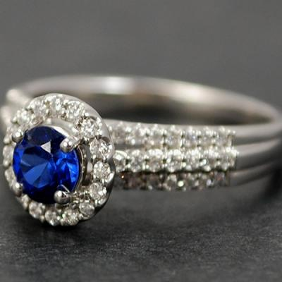 18ct White Gold Sapphire and Diamond Halo Cluster Ring in Modern Jewellery from Coopers Jewellery, North Devon